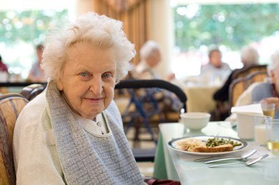 elderly lady at lunch in a Nursing Home