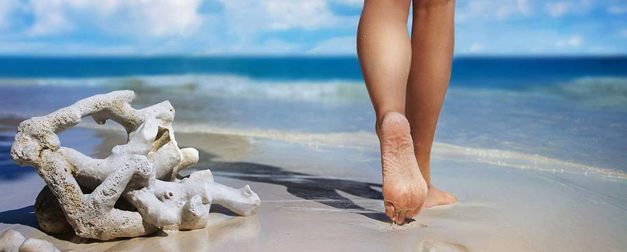 Dublin Foot Clinic- bare feet on the sand