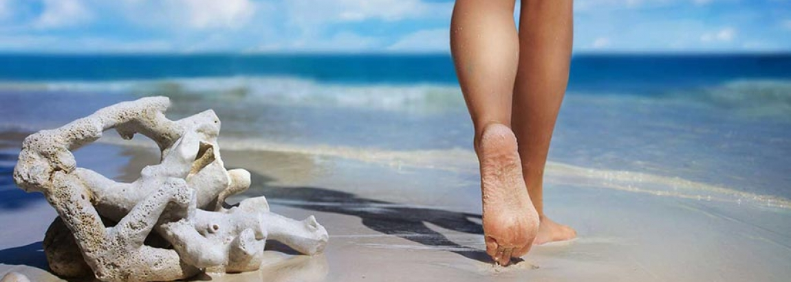 Dublin Foot Clinic- bare feet on the sand